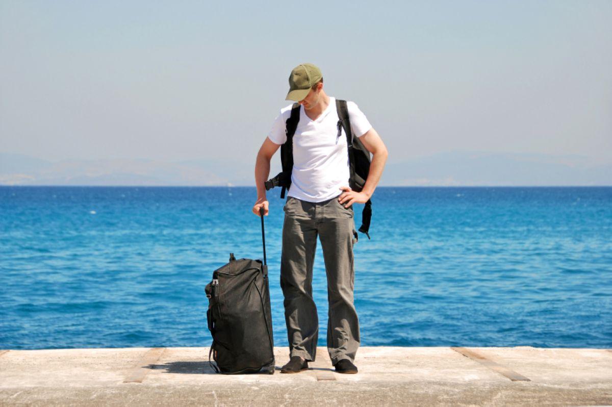 2013 03 18 06 Vacationing Alone Man Suitcase Beach Sea