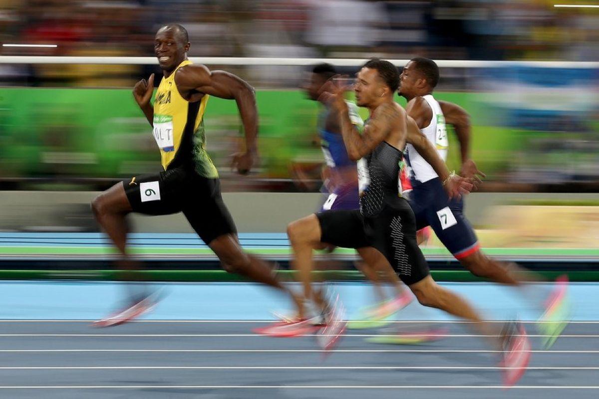 Olimpijskaya ulybka Usejna Bolta foto Useyn Bolt