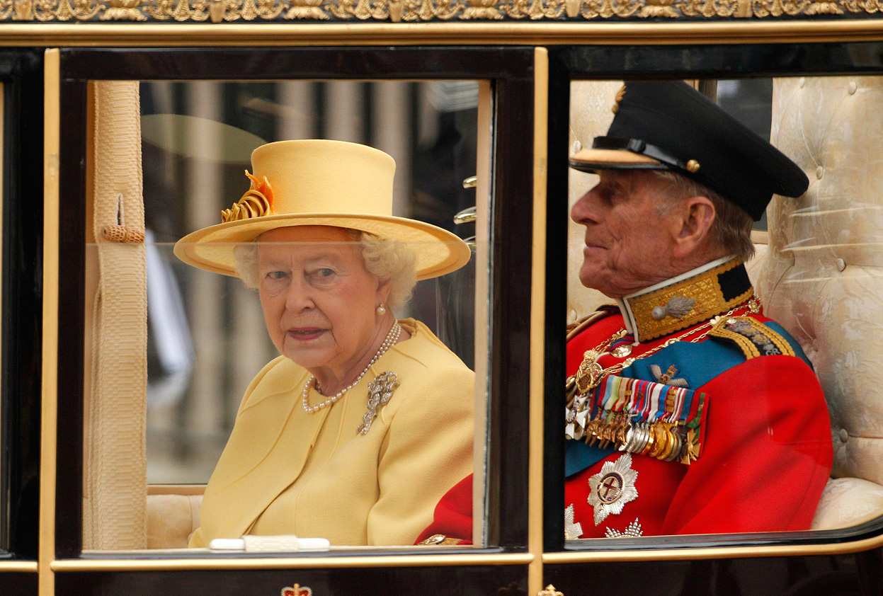 27 Britains Queen Elizabeth and Prince Philip travel to Buckingham Palace in a Semi State Landau along the Procession Route after the wedding of Prince William and Kate Middleton in Westminster Abbey