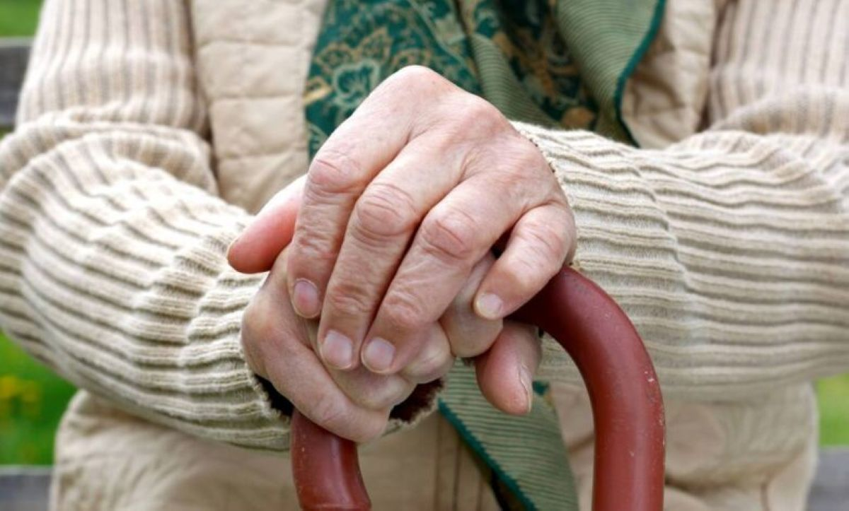 elderly persons hands with a cane alzheimers or parkinsons 16x9 1